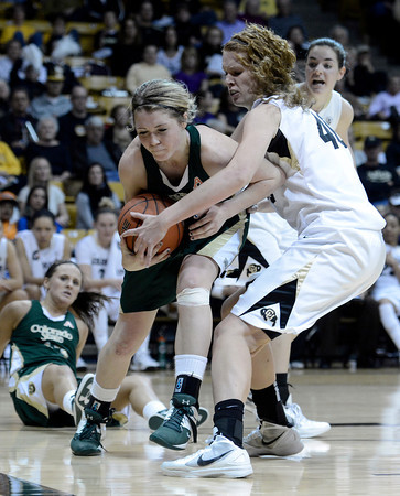 "Colorado State University's Caitlin Duffy fights for a rebound with University of Colorado's Rachel Hargis during a game on Wednesday, Dec. 5, at the Coors Event Center on the CU campus in Boulder. For more photos of the game go to  <a href=""http://www.dailycamera.com"">http://www.dailycamera.com</a><br /> Jeremy Papasso/ Camera"