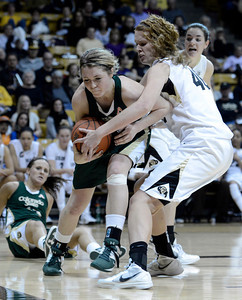 Colorado State University's Caitlin Duffy fights for a rebound with University of Colorado's Rachel Hargis during a game on Wednesday, Dec. 5, at the Coors Event Center on the CU campus in Boulder. For more photos of the game go to www.dailycamera.com Jeremy Papasso/ Camera