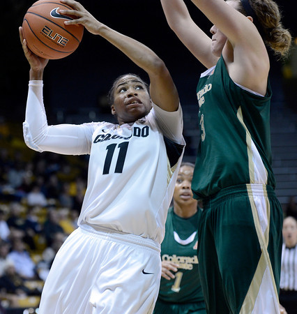 "University of Colorado's Brittany Wilson drives to the hoop past Hayley Thompson during a game against Colorado State University on Wednesday, Dec. 5, at the Coors Event Center on the CU campus in Boulder. For more photos of the game go to  <a href=""http://www.dailycamera.com"">http://www.dailycamera.com</a><br /> Jeremy Papasso/ Camera"