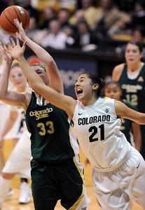 Jasmine Sborov, right, of CU, tries to get a rebound from Caitlin Duffy of CSU. For more photos from CU CSU basketball, go to www.dailycamera.com. Cliff Grassmick / December 5, 2012