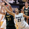 "Jasmine Sborov, right, of CU, tries to get a rebound from Caitlin Duffy of CSU.<br /> For more photos from CU CSU basketball, go to  <a href=""http://www.dailycamera.com"">http://www.dailycamera.com</a>.<br /> Cliff Grassmick / December 5, 2012"