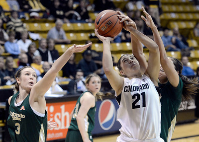 University of Colorado's Jasmine Sborov takes a shot over Hayley Thompson, left, and Kara Spotton, right, during a game against Colorado State University on Wednesday, Dec. 5, at the Coors Event Center on the CU campus in Boulder. For more photos of the game go to www.dailycamera.com Jeremy Papasso/ Camera
