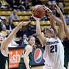 "University of Colorado's Jasmine Sborov takes a shot over Hayley Thompson, left, and Kara Spotton, right, during a game against Colorado State University on Wednesday, Dec. 5, at the Coors Event Center on the CU campus in Boulder. For more photos of the game go to  <a href=""http://www.dailycamera.com"">http://www.dailycamera.com</a><br /> Jeremy Papasso/ Camera"