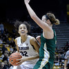 "University of Colorado's Arielle Roberson drives to the hoop past Hayley Thompson during a game against Colorado State University on Wednesday, Dec. 5, at the Coors Event Center on the CU campus in Boulder. For more photos of the game go to  <a href=""http://www.dailycamera.com"">http://www.dailycamera.com</a><br /> Jeremy Papasso/ Camera"