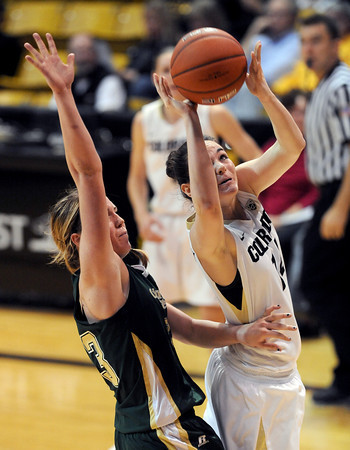 "Meagan Malcolm-Peck of CU shots past Caitlin Duffy of CSU.<br /> For more photos from CU CSU basketball, go to  <a href=""http://www.dailycamera.com"">http://www.dailycamera.com</a>.<br /> Cliff Grassmick / December 5, 2012"