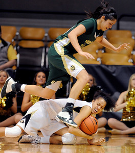 Kara Spotton of CSU, jumps over Arielle Roberson of CU on Wednesday. For more photos from CU CSU basketball, go to www.dailycamera.com. Cliff Grassmick / December 5, 2012