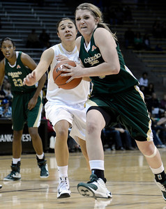 Colorado State University's Caitlin Duffy drives past University of Colorado's Jasmine Sborov during a game on Wednesday, Dec. 5, at the Coors Event Center on the CU campus in Boulder. For more photos of the game go to www.dailycamera.com Jeremy Papasso/ Camera
