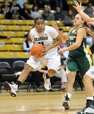 "Brittany Wilson of CU drives on Taylor Varsho of CSU.<br /> For more photos from CU CSU basketball, go to  <a href=""http://www.dailycamera.com"">http://www.dailycamera.com</a>.<br /> Cliff Grassmick / December 5, 2012"