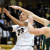 "Chucky Jeffery of CU drives past Caitlin Duffy of CSU in the first half.<br /> For more photos from CU CSU basketball, go to  <a href=""http://www.dailycamera.com"">http://www.dailycamera.com</a>.<br /> Cliff Grassmick / December 5, 2012"