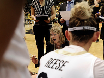 University of Colorado Head Coach Linda Lappe, center, talks with her team including Jen Reese, right, during a game against Colorado State University on Wednesday, Dec. 5, at the Coors Event Center on the CU campus in Boulder. For more photos of the game go to www.dailycamera.com Jeremy Papasso/ Camera