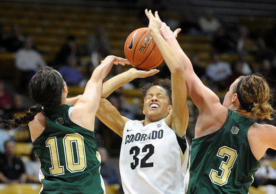 Arielle Roberson of CU is doubled by Emily Johnson and Hayley Thompson of CSU. For more photos from CU CSU basketball, go to www.dailycamera.com. Cliff Grassmick / December 5, 2012