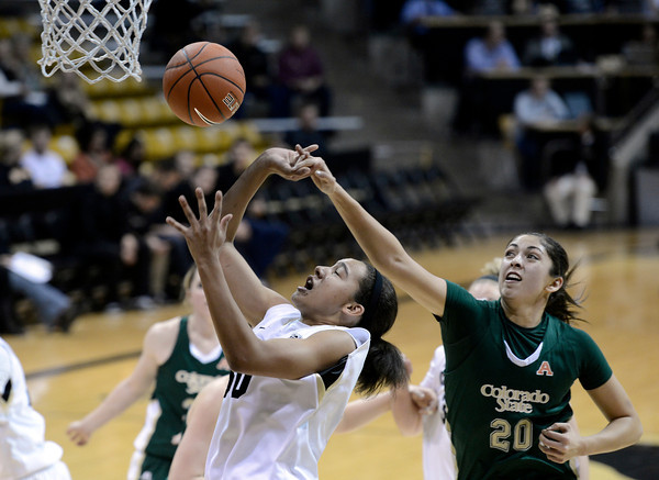 """University of Colorado's Jamee Swan gets fouled by Kara Spotton while going for a shot during a game against Colorado State University on Wednesday, Dec. 5, at the Coors Event Center on the CU campus in Boulder. For more photos of the game go to  <a href=""""http://www.dailycamera.com"""">http://www.dailycamera.com</a><br /> Jeremy Papasso/ Camera"""
