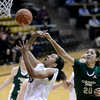 "University of Colorado's Jamee Swan gets fouled by Kara Spotton while going for a shot during a game against Colorado State University on Wednesday, Dec. 5, at the Coors Event Center on the CU campus in Boulder. For more photos of the game go to  <a href=""http://www.dailycamera.com"">http://www.dailycamera.com</a><br /> Jeremy Papasso/ Camera"