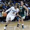 "University of Colorado's Brittany Wilson drives past Taylor Varsho during a game against Colorado State University on Wednesday, Dec. 5, at the Coors Event Center on the CU campus in Boulder. For more photos of the game go to  <a href=""http://www.dailycamera.com"">http://www.dailycamera.com</a><br /> Jeremy Papasso/ Camera"