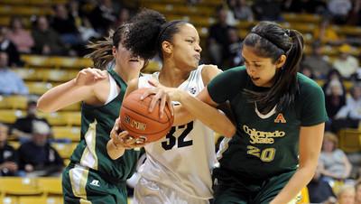 Arielle Roberson of CU battles for a rebound with Kara Spotton of CSU. For more photos from CU CSU basketball, go to www.dailycamera.com. Cliff Grassmick / December 5, 2012
