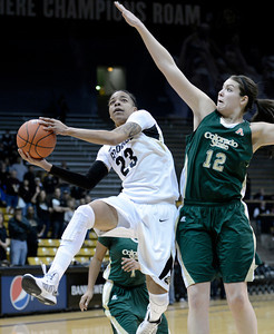 University of Colorado's Chucky Jeffery drives to the hoop past Meghan Heimstra during a game against Colorado State University on Wednesday, Dec. 5, at the Coors Event Center on the CU campus in Boulder. For more photos of the game go to www.dailycamera.com Jeremy Papasso/ Camera