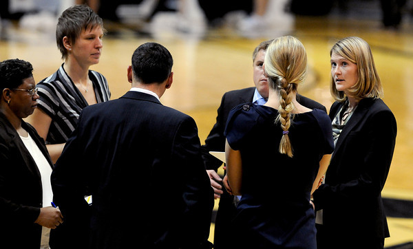 "CU coach Linda Lappe, right, talks with her staff during a timeout against CSU.<br /> For more photos from CU CSU basketball, go to  <a href=""http://www.dailycamera.com"">http://www.dailycamera.com</a>.<br /> Cliff Grassmick / December 5, 2012"