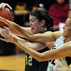"Arielle Roberson, right,  of CU tries to get the ball from  Sam Martin of CSU.<br /> For more photos from CU CSU basketball, go to  <a href=""http://www.dailycamera.com"">http://www.dailycamera.com</a>.<br /> Cliff Grassmick / December 5, 2012"