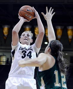 University of Colorado's Jen Reese takes a shot over Sam Martin during a game against Colorado State University on Wednesday, Dec. 5, at the Coors Event Center on the CU campus in Boulder. For more photos of the game go to www.dailycamera.com Jeremy Papasso/ Camera