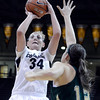 "University of Colorado's Jen Reese takes a shot over Sam Martin during a game against Colorado State University on Wednesday, Dec. 5, at the Coors Event Center on the CU campus in Boulder. For more photos of the game go to  <a href=""http://www.dailycamera.com"">http://www.dailycamera.com</a><br /> Jeremy Papasso/ Camera"