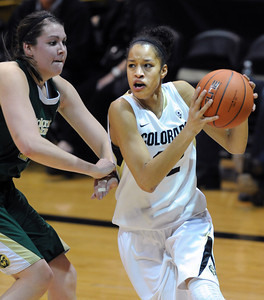 Arielle Roberson of CU drives on Sam Martin of CSU. For more photos from CU CSU basketball, go to www.dailycamera.com. Cliff Grassmick / December 5, 2012