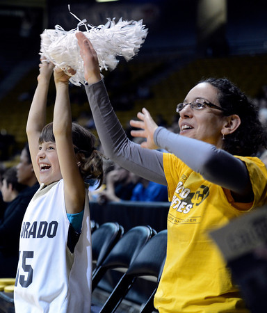 "University of Colorado fans Lila Rosenthal, right, and her daughter Della Baker-Rosenthal cheer during a women's game against Colorado State University on Wednesday, Dec. 5, at the Coors Event Center on the CU campus in Boulder. For more photos of the game go to  <a href=""http://www.dailycamera.com"">http://www.dailycamera.com</a><br /> Jeremy Papasso/ Camera"