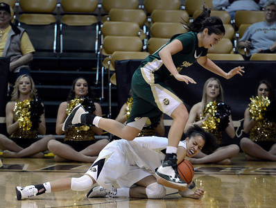 University of Colorado's Arielle Roberson dives for a loose ball under Kara Spotton during a game against Colorado State University on Wednesday, Dec. 5, at the Coors Event Center on the CU campus in Boulder. For more photos of the game go to www.dailycamera.com Jeremy Papasso/ Camera