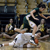 "University of Colorado's Arielle Roberson dives for a loose ball under Kara Spotton during a game against Colorado State University on Wednesday, Dec. 5, at the Coors Event Center on the CU campus in Boulder. For more photos of the game go to  <a href=""http://www.dailycamera.com"">http://www.dailycamera.com</a><br /> Jeremy Papasso/ Camera"