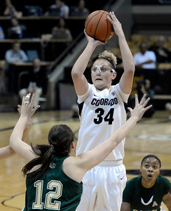 University of Colorado's Jen Reese takes a shot over Sam Martin, No. 12, during a game against Colorado State University on Wednesday, Dec. 5, at the Coors Event Center on the CU campus in Boulder. For more photos of the game go to www.dailycamera.com Jeremy Papasso/ Camera