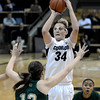 "University of Colorado's Jen Reese takes a shot over Sam Martin, No. 12, during a game against Colorado State University on Wednesday, Dec. 5, at the Coors Event Center on the CU campus in Boulder. For more photos of the game go to  <a href=""http://www.dailycamera.com"">http://www.dailycamera.com</a><br /> Jeremy Papasso/ Camera"