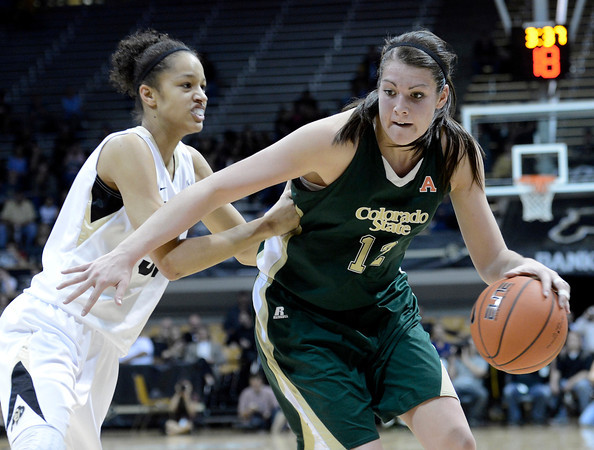 """Colorado State University's Sam Martin drives past University of Colorado's Arielle Roberson during a game on Wednesday, Dec. 5, at the Coors Event Center on the CU campus in Boulder. For more photos of the game go to  <a href=""""http://www.dailycamera.com"""">http://www.dailycamera.com</a><br /> Jeremy Papasso/ Camera"""