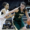 "Colorado State University's Sam Martin drives past University of Colorado's Arielle Roberson during a game on Wednesday, Dec. 5, at the Coors Event Center on the CU campus in Boulder. For more photos of the game go to  <a href=""http://www.dailycamera.com"">http://www.dailycamera.com</a><br /> Jeremy Papasso/ Camera"