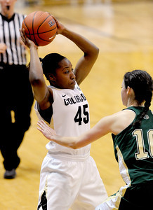 Kyleesha Weston of CU, looks to move on Emily Johnson of CSU. For more photos from CU CSU basketball, go to www.dailycamera.com. Cliff Grassmick / December 5, 2012