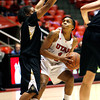 Utah's Janita Badon looks for an opening against Colorado during an NCAA college basketball game on Saturday, Dec. 31, 2011, in Salt Lake City. Colorado won 58-52. (AP Photo/The Salt Lake Tribune, Francisco Kjolseth) LOCAL TV OUT; DESERET NEWS OUT