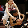 Utah's Rachel Morris, top, reaches for the ball held by Colorado's Ashley Wilson during an NCAA college basketball game on Saturday, Dec. 31, 2011, in Salt Lake City. Colorado won 58-52. (AP Photo/The Salt Lake Tribune, Francisco Kjolseth) LOCAL TV OUT; DESERET NEWS OUT