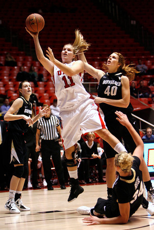 Utah's Taryn Wicijowski (11) reaches up for a basket against Colorado during an NCAA college basketball game on Saturday, Dec. 31, 2011, in Salt Lake City. (AP Photo/The Salt Lake Tribune, Francisco Kjolseth) LOCAL TV OUT; DESERET NEWS OUT