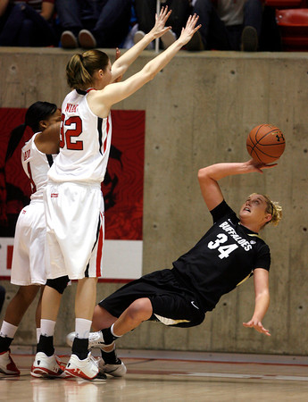 Colorado's Jen Reese, right, faces a wall of defense by Colorado during an NCAA college basketball game on Saturday, Dec. 31, 2011, in Salt Lake City. Colorado won 58-52. (AP Photo/The Salt Lake Tribune, Francisco Kjolseth) LOCAL TV OUT; DESERET NEWS OUT