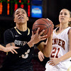 "University of Colorado's Chucky Jeffery drives to the hoop past Michaela Neuhaus during a games against the University of Denver on Tuesday, Dec. 11, at the Magnus Arena on the DU campus in Denver. For more photos of the game go to  <a href=""http://www.dailycamera.com"">http://www.dailycamera.com</a><br /> Jeremy Papasso/ Camera"