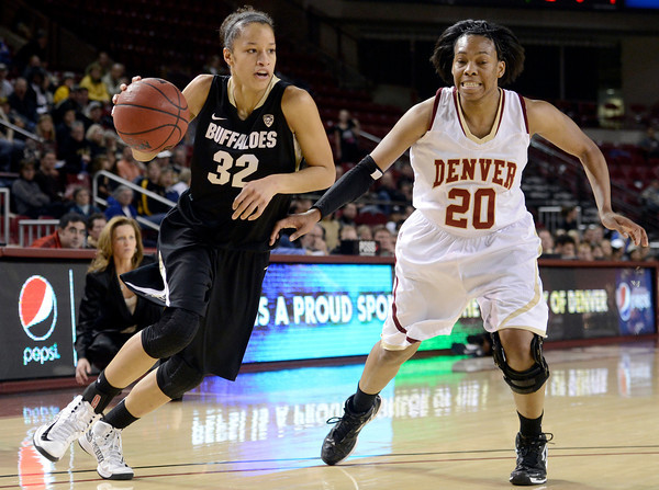 "University of Colorado's Arielle Roberson drives past Maiya Michel during a games against the University of Denver on Tuesday, Dec. 11, at the Magnus Arena on the DU campus in Denver. For more photos of the game go to  <a href=""http://www.dailycamera.com"">http://www.dailycamera.com</a><br /> Jeremy Papasso/ Camera"