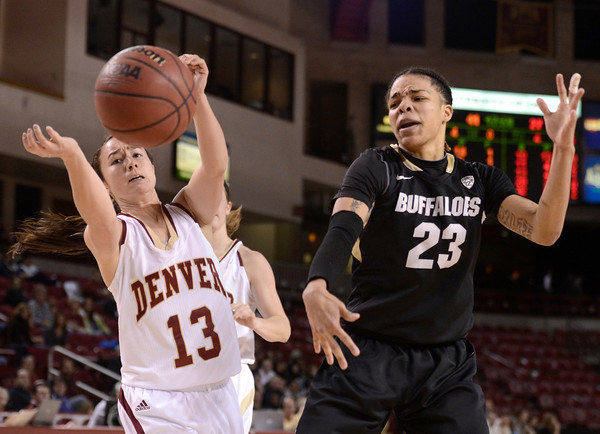 """University of Colorado's Chucky Jeffery fights for a loose ball with Emiko Smith during a games against the University of Denver on Tuesday, Dec. 11, at the Magnus Arena on the DU campus in Denver. For more photos of the game go to  <a href=""""http://www.dailycamera.com"""">http://www.dailycamera.com</a><br /> Jeremy Papasso/ Camera"""