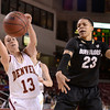"University of Colorado's Chucky Jeffery fights for a loose ball with Emiko Smith during a games against the University of Denver on Tuesday, Dec. 11, at the Magnus Arena on the DU campus in Denver. For more photos of the game go to  <a href=""http://www.dailycamera.com"">http://www.dailycamera.com</a><br /> Jeremy Papasso/ Camera"