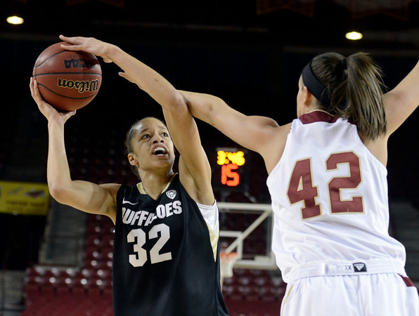 """University of Colorado's Arielle Roberson takes a shot over Alison Janecek during a games against the University of Denver on Tuesday, Dec. 11, at the Magnus Arena on the DU campus in Denver. For more photos of the game go to  <a href=""""http://www.dailycamera.com"""">http://www.dailycamera.com</a><br /> Jeremy Papasso/ Camera"""