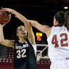 "University of Colorado's Arielle Roberson takes a shot over Alison Janecek during a games against the University of Denver on Tuesday, Dec. 11, at the Magnus Arena on the DU campus in Denver. For more photos of the game go to  <a href=""http://www.dailycamera.com"">http://www.dailycamera.com</a><br /> Jeremy Papasso/ Camera"