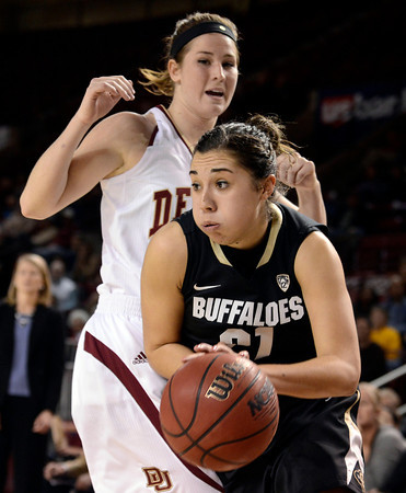 "University of Colorado's Jasmine Sborov drives to the hoop during a games against the University of Denver on Tuesday, Dec. 11, at the Magnus Arena on the DU campus in Denver. For more photos of the game go to  <a href=""http://www.dailycamera.com"">http://www.dailycamera.com</a><br /> Jeremy Papasso/ Camera"