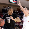 "University of Colorado's Brittany Wilson drives past Emiko Smith during a games against the University of Denver on Tuesday, Dec. 11, at the Magnus Arena on the DU campus in Denver. For more photos of the game go to  <a href=""http://www.dailycamera.com"">http://www.dailycamera.com</a><br /> Jeremy Papasso/ Camera"