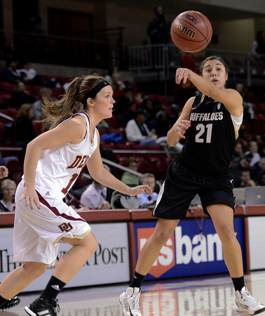 "University of Colorado's Jasmine Sborov passes the ball in front of Morgan Van Riper-Rose during a games against the University of Denver on Tuesday, Dec. 11, at the Magnus Arena on the DU campus in Denver. For more photos of the game go to  <a href=""http://www.dailycamera.com"">http://www.dailycamera.com</a><br /> Jeremy Papasso/ Camera"