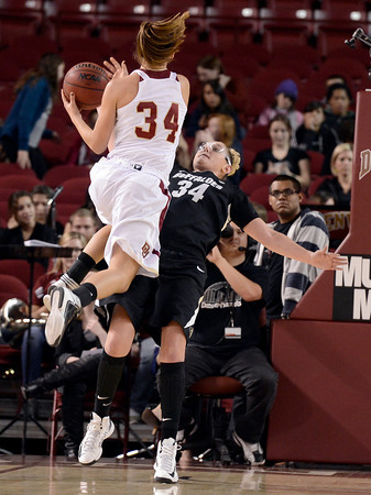 """University of Colorado's Jen Reese plays defense on Theresa Wirth during a games against the University of Denver on Tuesday, Dec. 11, at the Magnus Arena on the DU campus in Denver. For more photos of the game go to  <a href=""""http://www.dailycamera.com"""">http://www.dailycamera.com</a><br /> Jeremy Papasso/ Camera"""