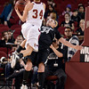 "University of Colorado's Jen Reese plays defense on Theresa Wirth during a games against the University of Denver on Tuesday, Dec. 11, at the Magnus Arena on the DU campus in Denver. For more photos of the game go to  <a href=""http://www.dailycamera.com"">http://www.dailycamera.com</a><br /> Jeremy Papasso/ Camera"