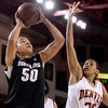 "University of Colorado's Jamee Swan takes a shot over Desiree Hunter during a games against the University of Denver on Tuesday, Dec. 11, at the Magnus Arena on the DU campus in Denver. For more photos of the game go to  <a href=""http://www.dailycamera.com"">http://www.dailycamera.com</a><br /> Jeremy Papasso/ Camera"