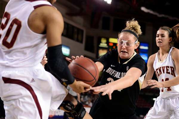 "University of Colorado's Jen Reese fights for a loose ball with Maiya Michel during a games against the University of Denver on Tuesday, Dec. 11, at the Magnus Arena on the DU campus in Denver. For more photos of the game go to  <a href=""http://www.dailycamera.com"">http://www.dailycamera.com</a><br /> Jeremy Papasso/ Camera"